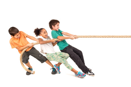 pretty young girl: Group of children in a rope-pulling contest