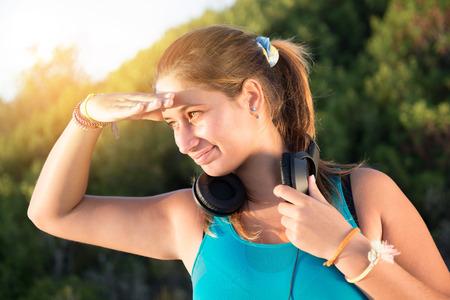 jogger: Beautiful girl jogger outdoors with headphones Stock Photo