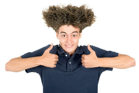 crazy hair: Happy teenager boy making faces with crazy hair isolated in white