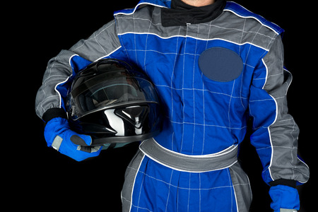 bodypart: Racing driver body-part with helmet isolated in black Stock Photo