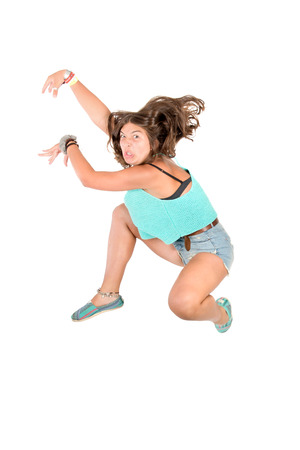 acrobatic: Young girl doing funny acrobatic jumps isolated in white