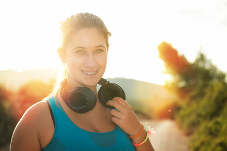 Beautiful girl jogger outdoors with headphones Stock Photo