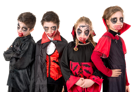 Group of kids with face-paint and Halloween vampire costumes Stock Photo