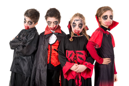 trick or tread: Group of kids with face-paint and Halloween vampire costumes Stock Photo
