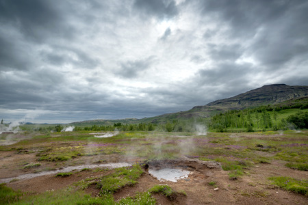 atraction: Geysir smoking, touristic atraction in Iceland,  June