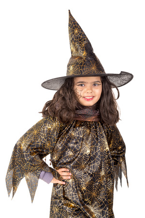 haunt: Girl with face-paint and Halloween witch costume isolated in white