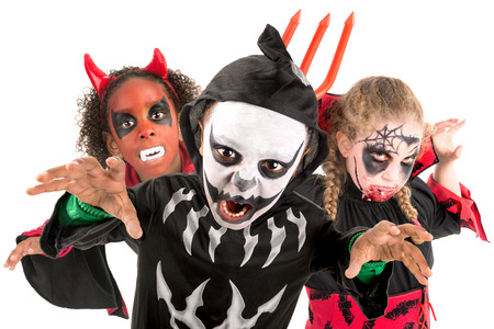 trick or tread: Group of kids with face-paint and Halloween costumes