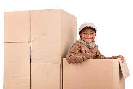 safari game drive: Young boy posing inside a cardboard box playing