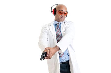 crime solving: Investigator processing a hand gun