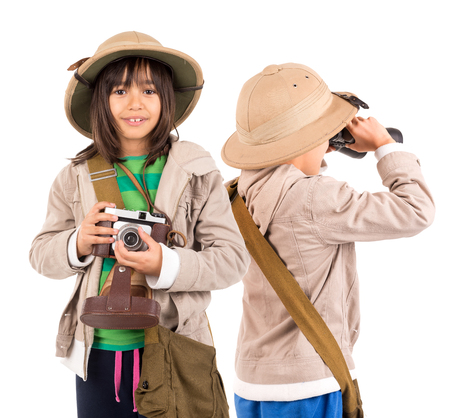 childen: Young childen with binoculars and camera playing Safari isolated in white