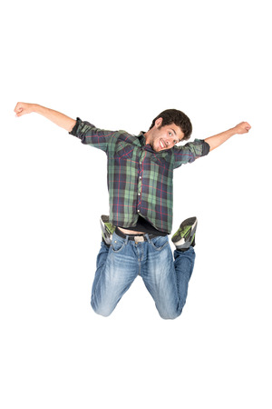 acrobatic: Teenage boy  doing funny acrobatic jumps isolated in white