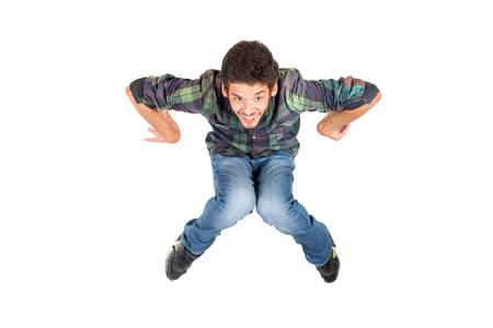 agility people: Teenage boy  doing funny acrobatic jumps isolated in white