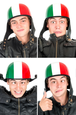 making faces: Teenager boy with helmet making faces isolated in white