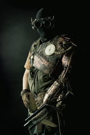 bionics: Futuristic soldier posing with gun and armor Stock Photo