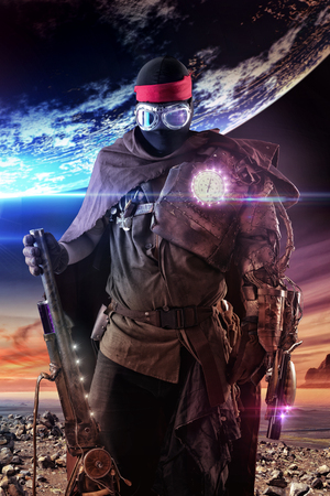 Futuristic soldier posing with gun and armor Stock Photo