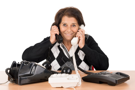 desperate: Desperate senior woman with several phones isolated in white