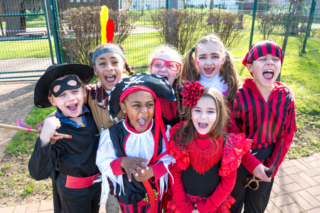 treads: Group of kids in Haloween costumes in a park