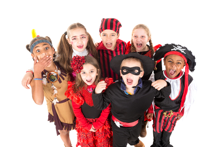 trick or tread: Group of kids in Haloween costumes isolated in white