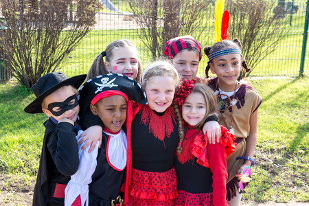 trick or tread: Group of kids in Haloween costumes in a park