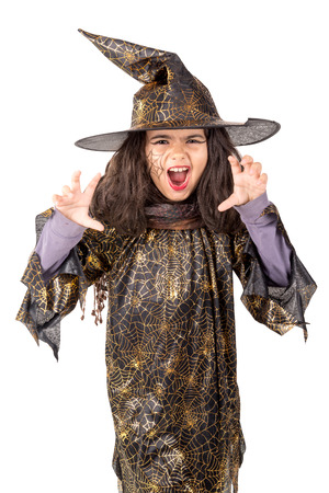 Girl with face-paint and Halloween witch costume isolated in white