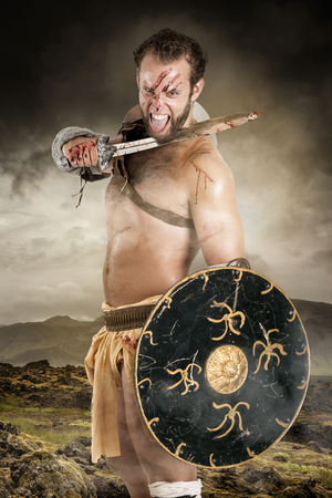 Ancient barbarian warrior or Gladiator ready to fight Stock Photo