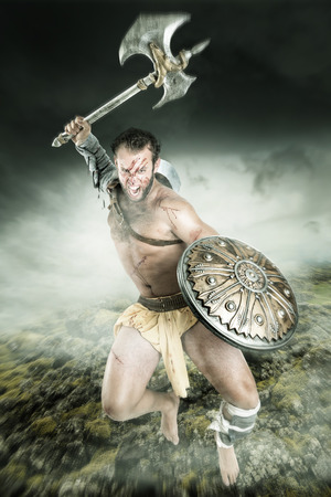 Ancient warrior or Gladiator fighting in a dark environment Stock Photo
