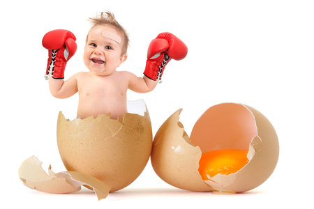 boy boxing: Beautiful baby boy with boxing gloves breaking the egg