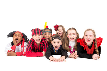 trick or tread: Group of kids in Halloween costumes isolated in white