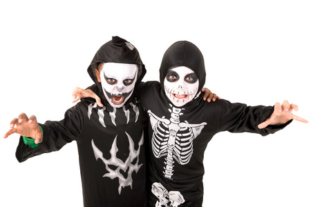 trick or tread: Kids posing in Halloween costumes isolated in white