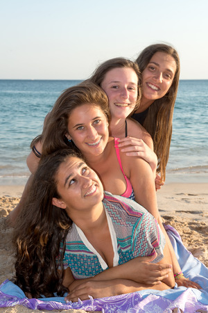 Group of happy teenage girls at the beach