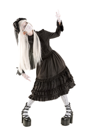 Widow in a black dress with white eyes looking like a doll isolated in white