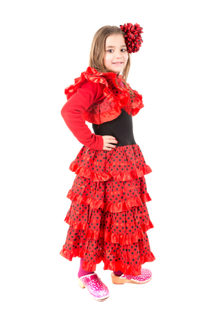 trick or tread: Youn girl in Spanish dancer costume isolated in white