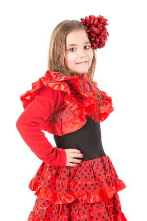 spanish dancer: Youn girl in Spanish dancer costume isolated in white
