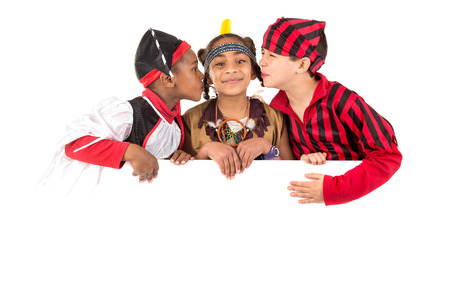 trick or tread: Group of kids with Halloween costumes over a white board isolated in white