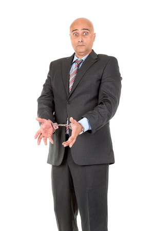 Businessman in handcuffs isolated in white background photo