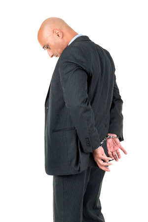 businessman suit: Businessman in handcuffs isolated in white background