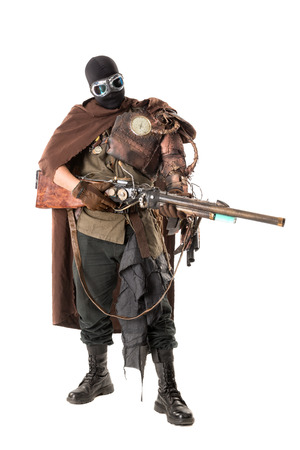 Futuristic soldier posing with gun and armor isolated in white