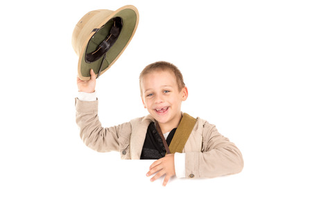 game drive: Young boy holding Safari hat isolated in white Stock Photo