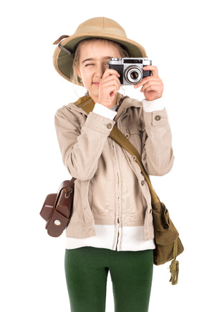 Young girl with a camera playing Safari isolated in white