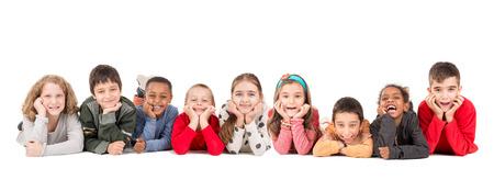 Grupo de niños felices posando aislado en blanco Foto de archivo - 69060054