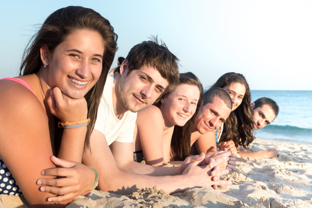 Group of happy teenage friends at the beach Stock Photo