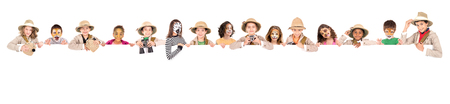 Childrens group in safari clothes and animal face-paint over a white board Stock Photo