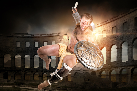 Ancient warrior or Gladiator ready to fight in the arena Imagens