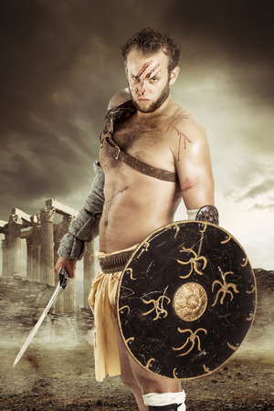 conquest: Ancient barbarian warrior or Gladiator ready to fight Stock Photo