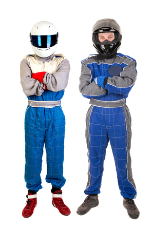 Racing drivers posing with helmet isolated in white Stock Photo