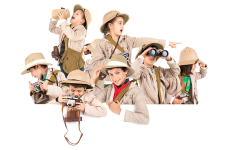 Childrens group with safari clothes and gear over a white board Stock Photo