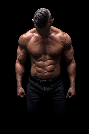 Power athletic man with great physique. Strong bodybuilder with six pack, perfect abs, shoulders, biceps, triceps and chest.