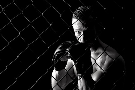 Strong Mixed Martial Arts fighter inside the cage