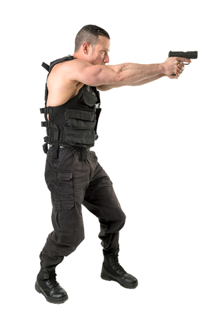 Man with tactical vest and gun isolated in white Imagens
