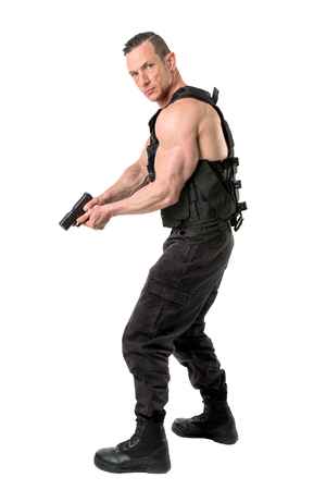 Man with tactical vest and gun isolated in white Banco de Imagens